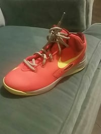 Orange Nike basketball shoes kds