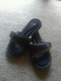 pair of black leather slide sandals Erie, 16509