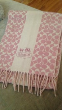 white and pink Coach fringe towel