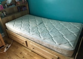 Wood Twin bed with head board.