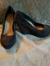 pair of black suede wedge shoes Charlotte