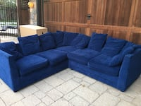 Blue suede sectional couch with throw pillows 561 km