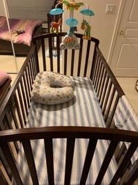 baby's brown wooden crib Vancouver, V6P 3J9