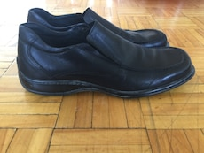 pair of black leather slip on dress shoes
