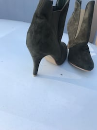 Pair of olive green booties. Size 7.5 Henderson, 89044