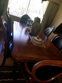 Beautiful leather chairs and table dining room set