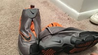 Pair of gray-and-orange nike shoes