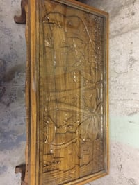 Engraved rectangular brown wooden coffee table
