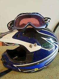 blue and white dirt motocross helmet with goggles