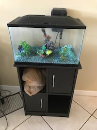 10 gallon fish tank with stand. Includes extra filter, heater, vacuum, air pump, chemicals, food. Everything you need except fish and water Wellington, 33414