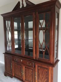 Brown wooden framed glass display cabinet Annapolis, 21108