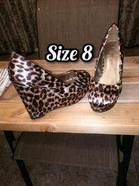 Size 8 cheetah wedges  Lubbock, 79416