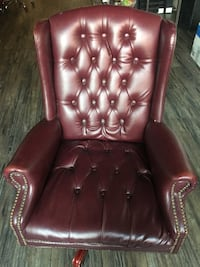 Leather burgundy rolling chair. Adjustable height  New York, 10451