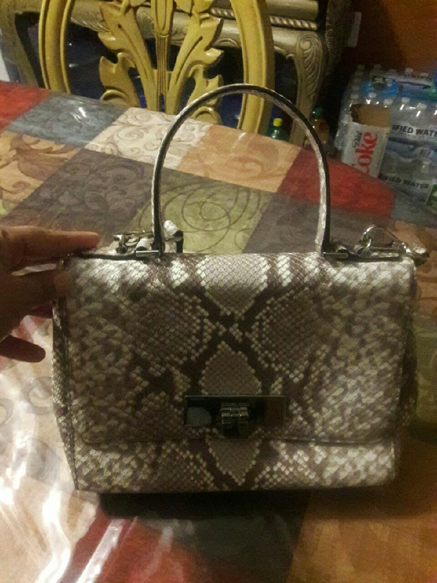 grey and black snake skin hand bag