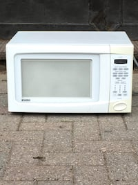 white General Electric microwave oven London, N6J 1E3