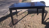 rectangular black wooden coffee table