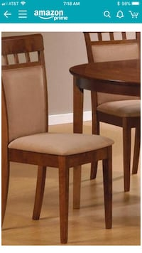 8 new dining chairs. New in the box. Paid 800 for set of 8 chairs. Selling for 500. Walnut dining chairs. Come check them out! Clarksburg, 20871