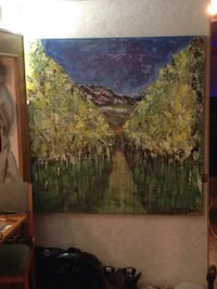 brown wooden framed painting of forest Kelowna