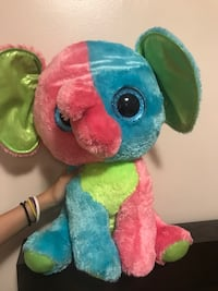 green, pink, and, blue elephant plush toy