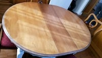 oval brown wooden dining table Calgary