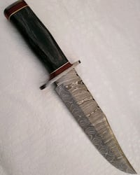 Best quality Damascus steel hunting knife.  Dhedo Basra