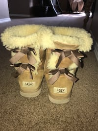 pair of brown UGG boots 2463 km