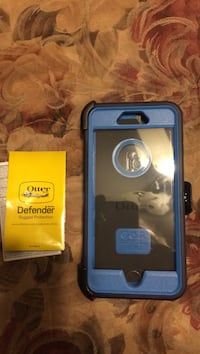 Blue otterbox defender smartphone case with manual never used