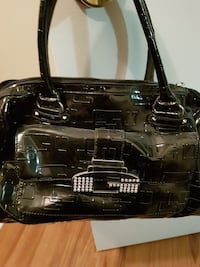 black monogrammed Guess patent leather bowler bag