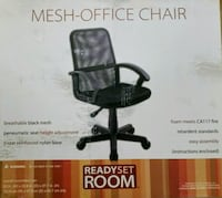 Black mesh office chair. New, stiil in the box. University Place, 98466