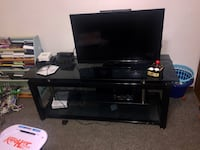 Must go today. make me an offer !!!!!  Black glass entertainment TV stand. El Cajon