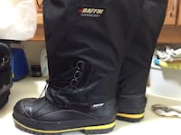 black-and-yellow Baffin knee-high duck boots 507 km