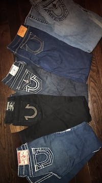 two black and blue denim shorts