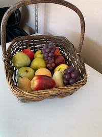 Basket with plastic fruit