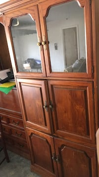 brown wooden framed glass cabinet Ocala, 34474