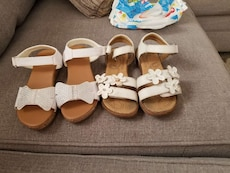 two pairs of brown-and-white sandals