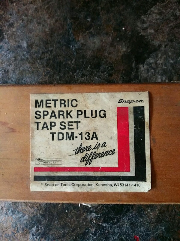Snap on spark plug tap set