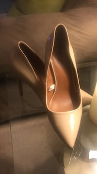 pair of nude-colored pointed toe heeled shoes