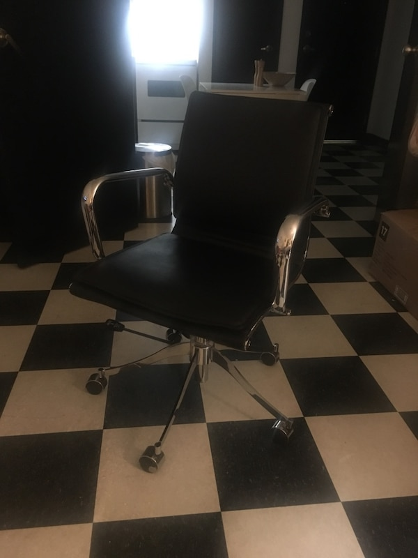 black and gray leather padded rolling chair screenshot 6cafe580-02f5-45ba-9dcf-04dfe10b6660