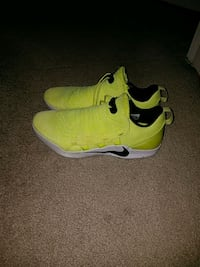 pair of yellow-and-black Nike running shoes Manassas