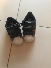 Pair of black-and-white adidas sneakers 548 km