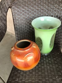 Two yellow and green ceramic vases