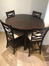 Round dark brown wooden table with four chairs dining set Fairfax, 22035