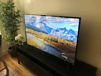 "55"" 4K flat screen tv with remote 2415 mi"