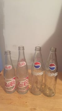 Four pepsi-cola glass bottles