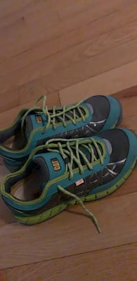 Pair of blue-and-green safety shoes. size is USA 10 Brampton, L6R 0P2