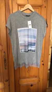 Brand with tags on Tshirt