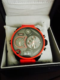 round red framed black and gray Diesel chronograph watch with red band