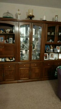 brown wooden framed glass display cabinet 549 km