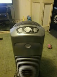 black and gray portable air purifier  33 km