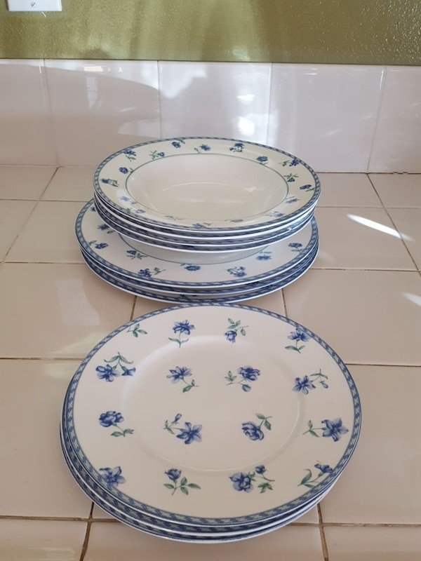 white and blue ceramic bowls and plates